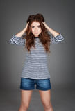 Red-haired girl with freckles in the studio. Teen girl with brig Stock Photo