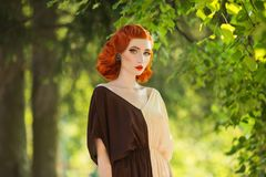 Beautiful red-haired retro girl with clean healthy skin and blue eyes. Fashion vintage model Royalty Free Stock Image