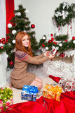 Red-haired girl with a gift. Christmas, Red-haired girl with a gift Royalty Free Stock Photo