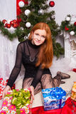 Red-haired girl with a gift. Christmas. Red-haired girl with a gift Royalty Free Stock Photo