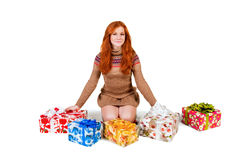 Red-haired girl with a gift Stock Images