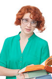 Red-haired girl in glasses with books Royalty Free Stock Photography