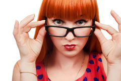 Red-haired girl in glasses. Pin-up 50s style red-haired girl in glasses on white background royalty free stock photos
