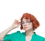 Red-haired girl in glasses thinking isolated on white Royalty Free Stock Image