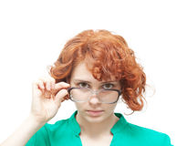 Red-haired girl in glasses thinking isolated on white Royalty Free Stock Photo