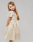 Red-haired girl in a golden dress Royalty Free Stock Images