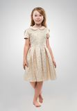 Red-haired girl in a golden dress Royalty Free Stock Image