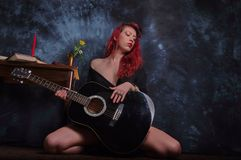 Red haired girl with guitar Stock Photo