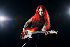 Red-haired girl the guitarist. Musician,  rock, heavy metal Stock Image