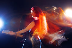 Red-haired girl the guitarist Royalty Free Stock Images