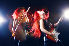 Red-haired girl the guitarist. Musician,  rock, heavy metal Royalty Free Stock Photo