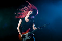 Red-haired girl the guitarist. Musician,  rock, heavy metal Stock Photo