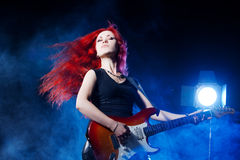 Red-haired girl the guitarist. Musician,  rock, heavy metal Royalty Free Stock Photos