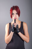 Red haired girl with the gun. Portrait of a red haired girl with the gun royalty free stock photography
