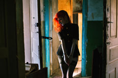 Red-haired girl. In handcuffs royalty free stock images