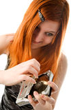 Red haired girl with hard drive. Red haired girl tearing old hard drive (focus on girl Stock Photos