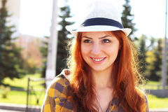 Red-haired girl in a hat hipster Stock Photos