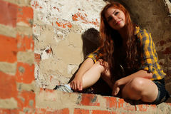 Red-haired girl in a hat hipster Stock Images