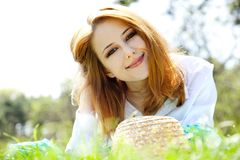 Red-haired girl with hat at the park. Stock Photo