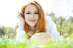 Red-haired girl with hat at the park. Royalty Free Stock Photo