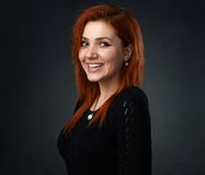 Red-haired girl having fun smiling Stock Photography