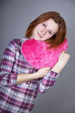 Red-haired girl with heart toy. Royalty Free Stock Photography