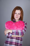 Red-haired girl with heart toy. Royalty Free Stock Photo