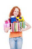 Red-haired girl holding many gift boxes Stock Photos