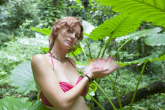 Red-haired girl. The red-haired girl in jungle Stock Photo