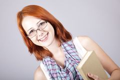 Red-haired girl keep book in hand. Royalty Free Stock Photography
