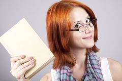 Red-haired girl keep book in hand. Royalty Free Stock Photo