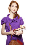 Red-haired girl keep book in hand. Stock Photos