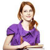 Red-haired girl keep book in hand. Royalty Free Stock Images