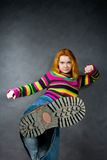 Red-haired girl kicks Royalty Free Stock Images