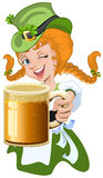 Red haired girl leprechaun holding a glass beer mug Royalty Free Stock Image