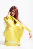 Red-haired girl in long elegant yellow dress Royalty Free Stock Images