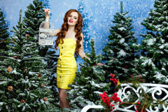 The red-haired girl with long hair in a yellow dress, surrounded stock photos