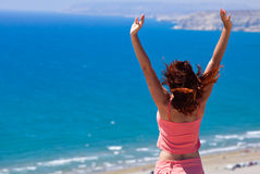 Red-haired girl is looking at sea Stock Photo