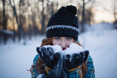 Red-haired girl with make-up in the woods in winter stock images