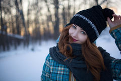 Red-haired girl with make-up in the woods in winter Stock Photography