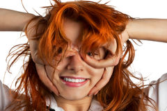 Red-haired girl makes out of its hands symbolic glasses Stock Photography