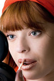 Red haired girl making up. Closeup Royalty Free Stock Photos
