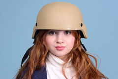 Red-haired girl in the military helmet. Beautiful red-haired girl in a military hat, the concept is not quiet time Stock Images