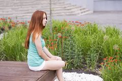 Red-haired girl in mint shirt stock photo