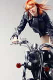 Red-haired girl on a motorbike Royalty Free Stock Photos