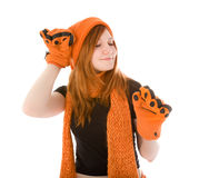 Red haired girl in orange hat Stock Images