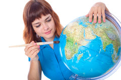 Red-haired girl is painting globe Royalty Free Stock Photos