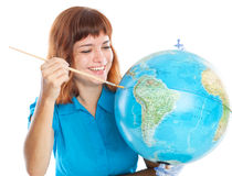 Red-haired girl is painting globe Royalty Free Stock Photo
