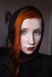 Red-haired girl with pale skin, blue eyes and burgundy, red lips with a shawl Royalty Free Stock Photography