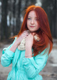 Red-haired girl in park royalty free stock images